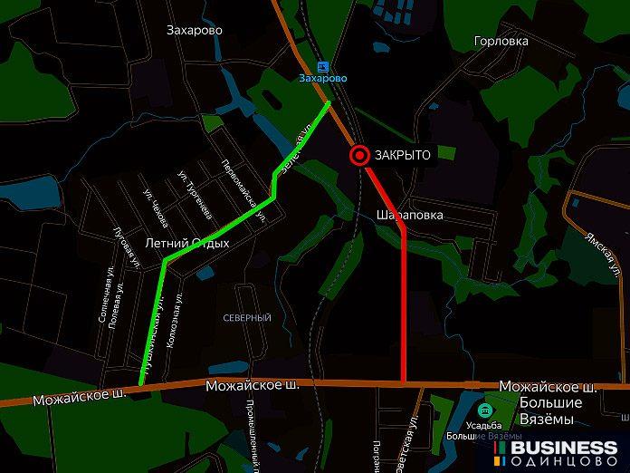 переезд на5 километре перегона Голицыно — Звенигород, расположенныйнаавтомобильной дороге А-107 вблизи остановочных пунктов Захарово иХлюпино