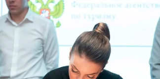 Зарина Догузова на круглом столе в Общественной палате на тему легализации малых средств размещения.